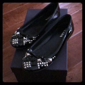 Black patent leather Prada ballet flats